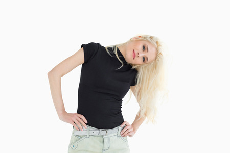cocked: Portrait of a beautiful casual young blond over white background