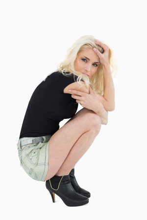 Portrait of a beautiful casual blond posing over white background photo