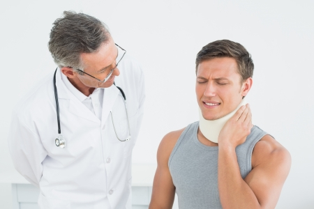 Male doctor listening to patient with concentration at medical office photo