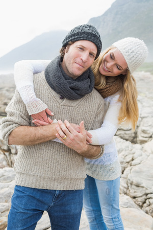 Portrait of a happy romantic young couple standing together\ on a rocky landscape