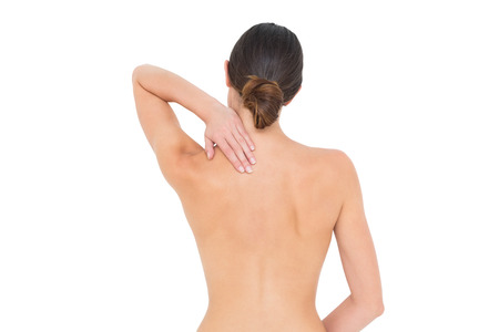 topless brunette: Rear view of a topless fit young woman with shoulder pain over white background
