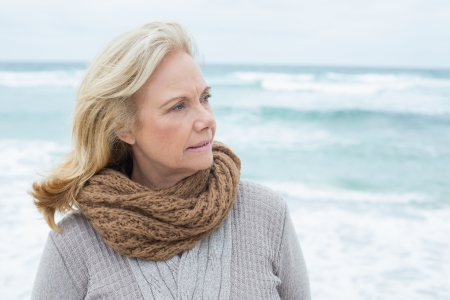 Close-up of a contemplative casual senior woman relaxing at the beach