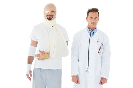 Portrait of a doctor with patient tied up in bandage over  white background photo