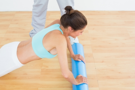 Side view of a young woman do push ups in the gym at hospital photo