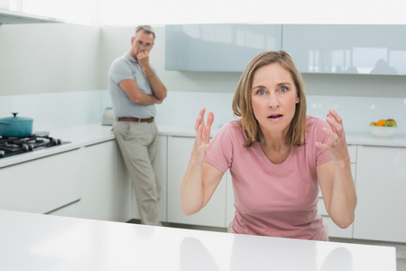 Unhappy couple not talking after an argument in the kitchen at home Stock Photo