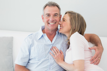 man woman hugging: Portrait of a happy couple embracing in the living room at home