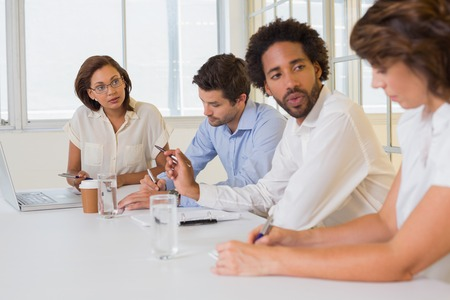 Group of young business people in meeting at the office