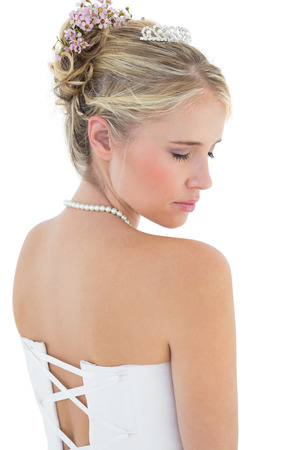 off the shoulder: Rear view of shy bride in off shoulder dress over white background