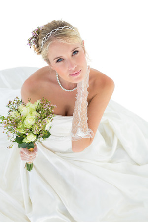 sensuous: High angle portrait of sensuous bride holding flower bouquet over white background Stock Photo