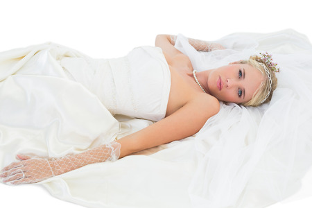 sensuous: Portrait of sensuous bride lying over white background Stock Photo