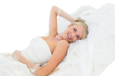 sensuous: Portrait of happy sensuous bride lying against white background