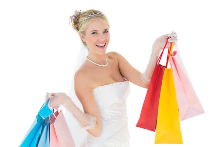 off the shoulder: Portrait of bride holding shopping bags over white background Stock Photo