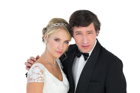 Portrait of newly wed couple with attitude over white background