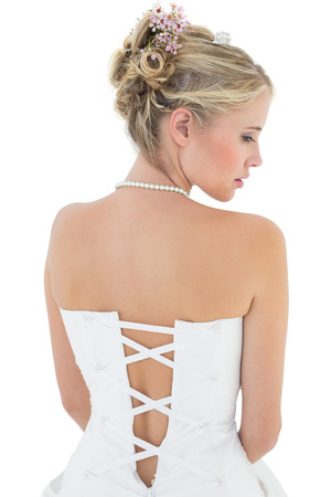 off shoulder: Rear view of young bride in off shoulder dress against white background