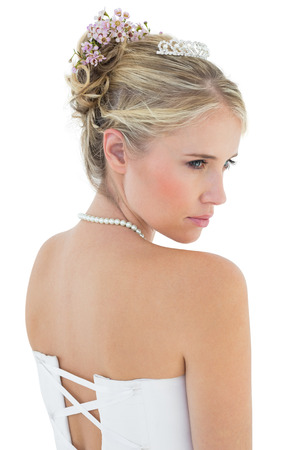 off the shoulder: Rear view of thoughtful bride in off shoulder dress over white background Stock Photo