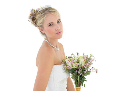 off the shoulder: Portrait of confident bride with flower bouquet over white background