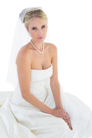 off the shoulder: Portrait of young bride in off shoulder dress over white background