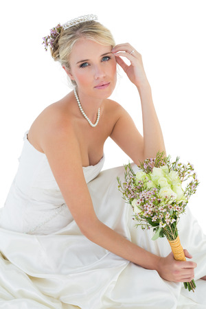 sensuous: Portrait of sensuous bride holding rose bouquet over white background