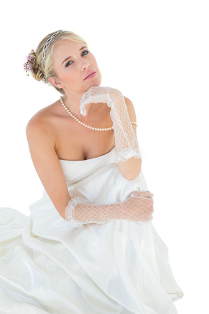 sensuous: Portrait of sensuous bride with hand on chin against white background
