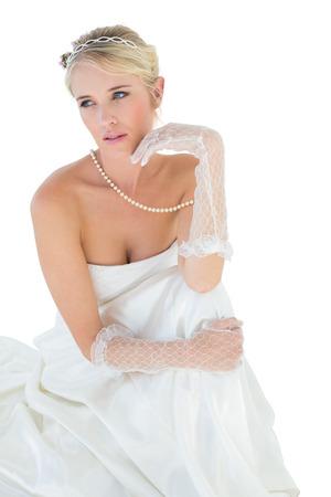 off the shoulder: Elegant bride thinking over white background