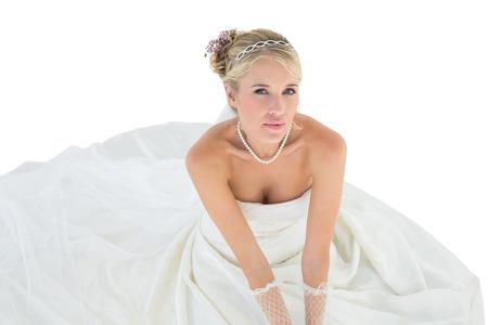 off shoulder: High angle portrait of elegant bride sitting over white background