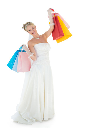 off the shoulder: Full length portrait of bride carrying shopping bags over white background Stock Photo