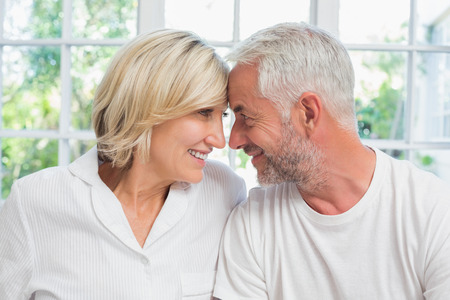 Close-up of a relaxed mature couple with head to head at home