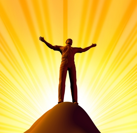 Belief and spirituality representing worship and the power of faith represented by a single man on the top of the mountain with his arms raised to god. Stock Photo - 10299795