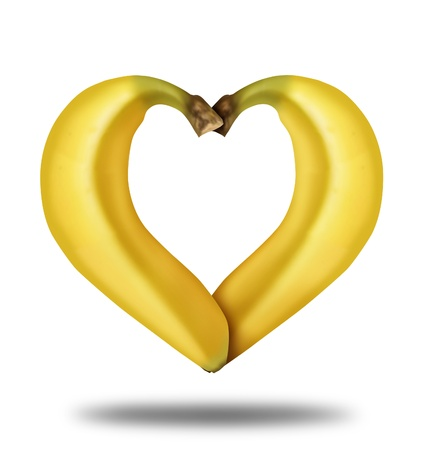 eating banana: Eating healthy food represented by two yellow ripe bananas in the shape of a heart isolated on a white background showing the concept of