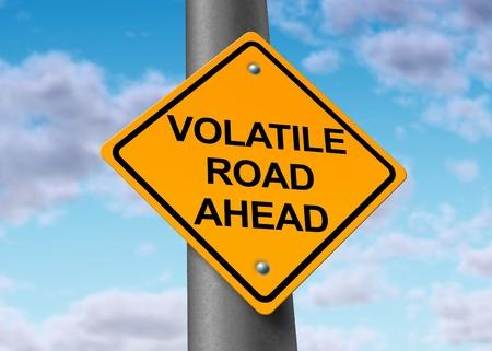volatility: Volatilidad en el s�mbolo burs�til representado por un signo de advertencia de carretera amarilla que muestra los peligros de un vol�til comercio sesion en el dow jones o wall street en que acciones ir arriba y abajo de una manera dram�tica. Foto de archivo