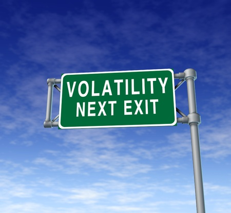Volatility in the stock market symbol represented by a green highway road sign showing the hazards of a volatile trading session at the dow jones or wall street in which equities go up and down like a roller coaster ride. photo