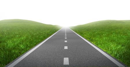 resulting: Open road highway with green grass and asphalt street representing the concept of journey to a focused destination resulting in success and happiness.