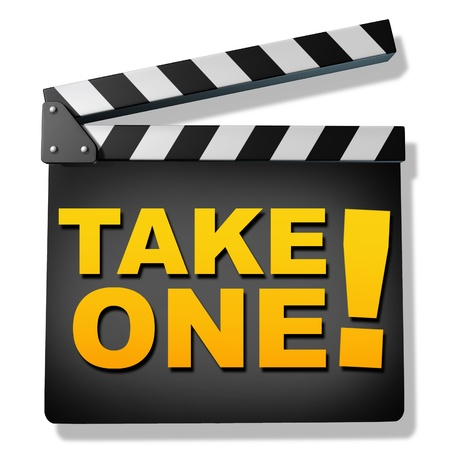 reviews: Film slate with the words take one representing film and cinema productions and hollywood reviews of new movies and telivision shows.