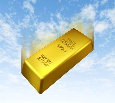 lingotes de oro: Caída del precio del oro representado por una barra de metal de color amarillo dorado bajando con un fondo de cielo azul que muestra el concepto de pérdida de valor en el comercio de lingotes preciosos. Foto de archivo