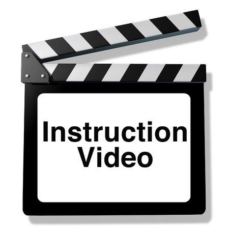 Instruction video for training and how to teaching using streaming internet media or other types of film as DVD and online viewing represented by a clapboard an film slate cinema symbol.. Фото со стока