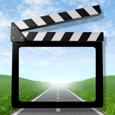 Travel video symbol representing the concept of traveling on a road and taking video of the vacation trip for business or family represented by a clapboard film slate with a road and sky.