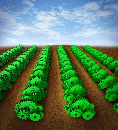 agricultural farm land: Investing and growth with future profit success represented by green gears and cogs representing crops on an agricultural farm land showing the concept of growing profits thanks to careful planning and strategy in the world of manufacturing industry and b Stock Photo