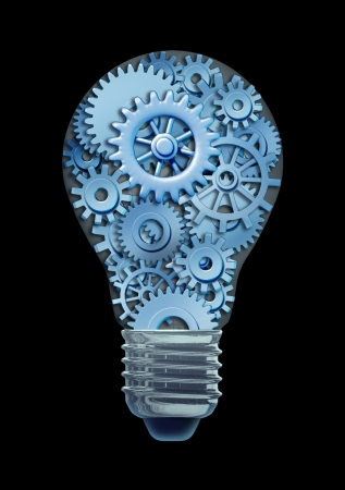 Working ideas and concepts featuring a light bulb with gears and cogs working together as a team representing teamwork and financial planning and strategy on a black background Standard-Bild