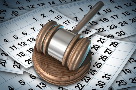delays: Delayed justice in the court system represented by a judge mallet on a bed of calendar pages showing how slow the law can be while waiting for procedures or sentence. Stock Photo