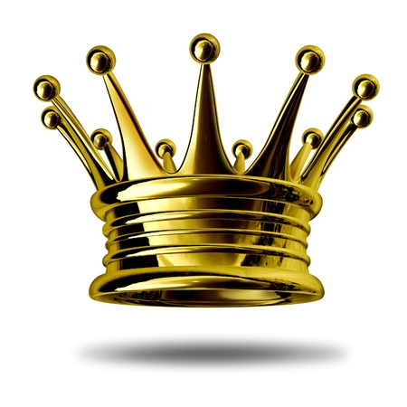 Gold crown representing royalty and wealth as an award symbol for nobility and leadership isolated on white. Archivio Fotografico