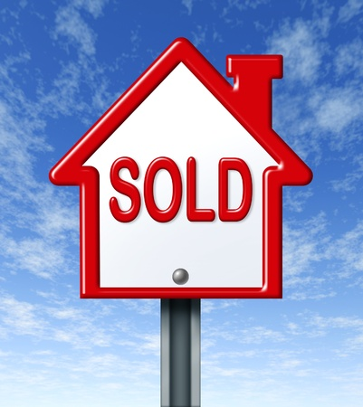 Real estate symbol for a sold home with sky background photo