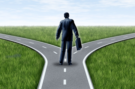 business dilemma: Career decision for a business man at a cross roads standing at a horizon with grass and blue sky showing a fork in the road representing the concept of a strategic dilemma choosing the right direction to go when facing two equal or similar job options.