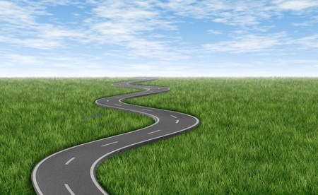 winding road: Curved winding asphalt road on a green grass horizon with a blue sky represented by a single highway on white background representing a clear focused strategic trip to a planned destination and journey. Stock Photo