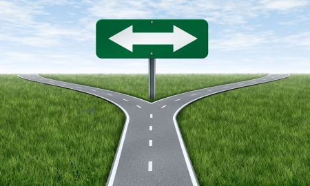 crossroads: Choice and choosing a direction in life or business using the rooad metaphore and highway sign with a fork shaped traffic lane showing the concept of dilema and selecting the right option. Stock Photo