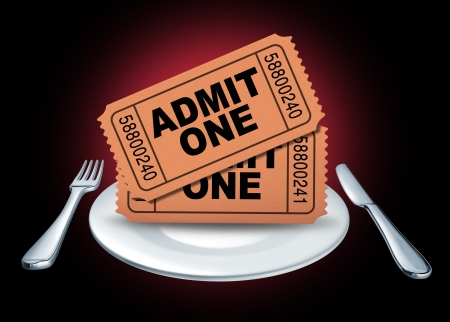 Dinner theater symbol represented by movie tickets for an entertainment event or show on a white plate with a fork and knife representing a night out of eating and enjoying cinema.
