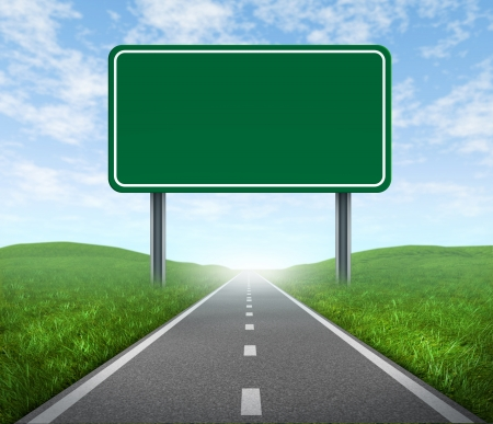 road travel: Road with blank highway sign with green grass and asphalt street representing the concept of journey to a focused destination resulting in success and happiness. Stock Photo