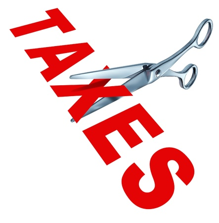 gastos: Tax cut and cutting taxes represented by metal scissors slashing the word taxes to show the concept of government political policy and campaign promisis to reduce the tax rate for the wealthy and the middle class tax payers. Imagens