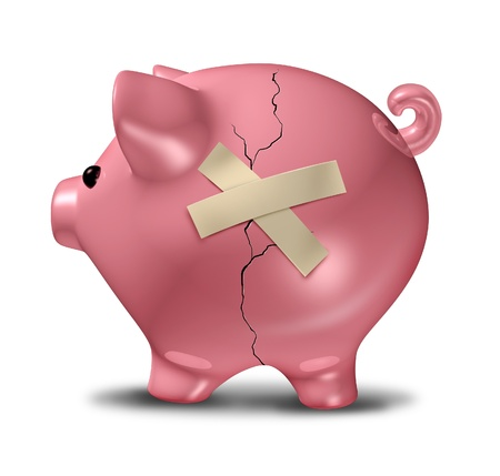 Financial recovery represented by a broken cracked piggy bank that is taped together for the symbol of troubled finances. photo
