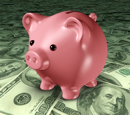 frugality: Piggybank on a pile of money representing the concept of long term savings and financial planning of investments.