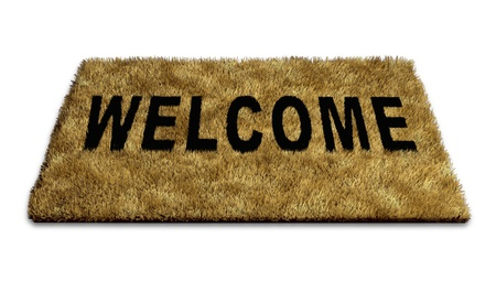 open sign: Welcome mat carpet isolated on white representing the concept of welcoming new ideas and people to a home or business and also symbolising the concept of open doors policy towards creative thinking. Stock Photo